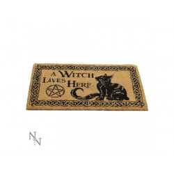DOORMAT A WITCH LIVES HERE...